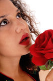 Face of woman with red rose. Stock Photo