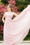 Face of woman is wearing pink flying dress Stock Images