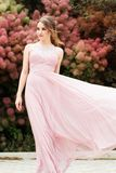 Face of woman is wearing pink flying dress Royalty Free Stock Photo