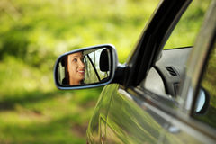 Face of women driving the car. Royalty Free Stock Image