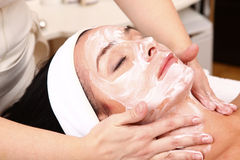 Face of women getting a spa treatment.  Stock Images