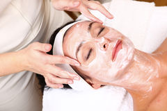 Face of women getting a spa treatment.  Stock Photos