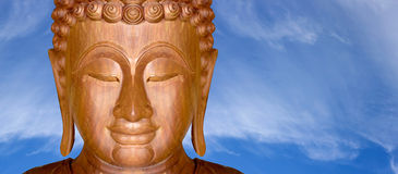 Face of wood Buddha of native Royalty Free Stock Image
