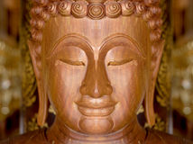 Face of wood Buddha of native Stock Photos