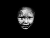 Face of the world. Little boy's face with a world map Royalty Free Stock Photo