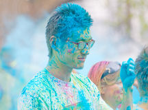 Face of young asian man covered with blue color powder Stock Photo