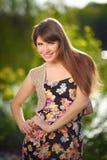 Face young beautiful girl dark closeups short hair summer park s Royalty Free Stock Images