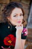 Face young beautiful girl dark closeups short hair Stock Photography