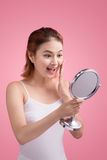 Face of young beautiful healthy asian woman and reflection in th. E mirror Stock Images