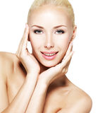 Face of the young beautiful smiling woman Royalty Free Stock Photo