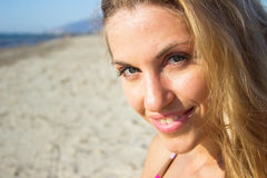 Face of young beautiful woman on beach Royalty Free Stock Photography