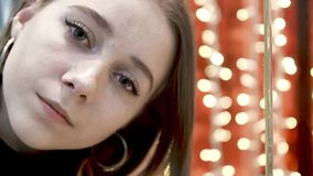 Face of young beautiful woman that is lost in big city store Sensual excitement on her face.  stock footage