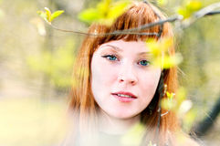 Face of the young beautiful woman outdoors Stock Photography