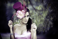 Face of young beautiful woman in a vintage hat Royalty Free Stock Photography