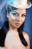 Face of young beautiful woman in a vintage hat. Royalty Free Stock Photography