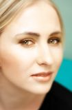 Face of young blond woman with green eyes Stock Photography