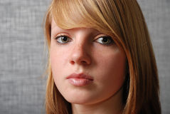Face of the young blonde teen Stock Photography