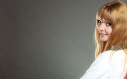 Face of young blonde woman with bangs Stock Photo