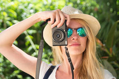 Face young blonde woman photographer taking photo with camera Royalty Free Stock Photo