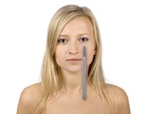 Face of young blonde woman and scalpel Stock Photos