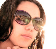 Face of young brunette girl in sunglasses with beach reflection Stock Photography