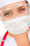 Face of a young doctor in a protective mask Stock Photos