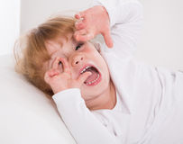 Face: young girl playing around on white background . Royalty Free Stock Photography