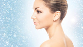 Face of young and healthy girl over winter background Royalty Free Stock Photos