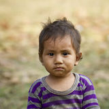 Face of a young kid in Népal Stock Images