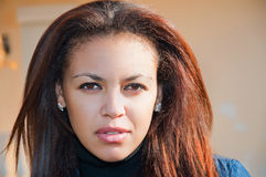 Face of a young mulatto woman close-up. Beautiful almond eyes Stock Photos