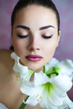 Face Of Young Woman With Amaryllis Royalty Free Stock Photos