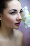 Face Of Young Woman With Amaryllis Stock Photos