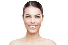 Face of young woman with clean skin and toothy smile Stock Images