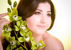 Face of the young woman with flower Royalty Free Stock Photo