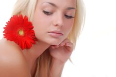 Face of young woman and flower Stock Photo