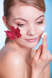 Face of young woman girl with red maple leaf cream Royalty Free Stock Photos