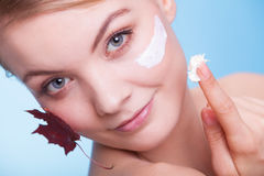 Face of young woman girl with red maple leaf cream Stock Images