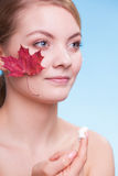 Face of young woman girl with red maple leaf cream Stock Photography