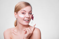 Face of young woman girl with red maple leaf cream Royalty Free Stock Photography
