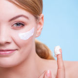 Face of young woman girl taking care of dry skin. Stock Photos