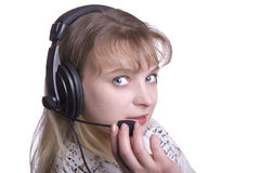 Face of young woman with headset Stock Photo