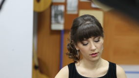 Face of a young woman playing grand piano at a concert stock footage