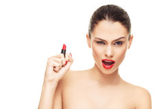 Face of young woman with red lipstick in hand Stock Photo