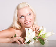 face of the young woman with white lily Stock Photo