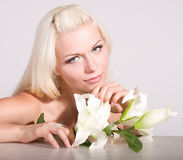 face of the young woman with white lily Stock Photos