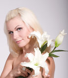 face of the young woman with white lily Stock Images