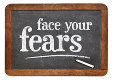 Face your fears advice on blackboard Royalty Free Stock Images