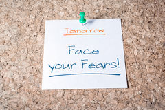 Face Your Fears Reminder For Tomorrow On Paper Pinned On Cork Board. A Face Your Fears Reminder For Tomorrow On Paper Pinned On Cork Board royalty free stock photo