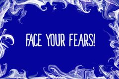 Face your fears written over blue background Royalty Free Stock Photo