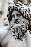Face of Zeus in Piazza Navona fountain, Rome Italy. Statue of the god Zeus in Bernini's Fountain of the Four Rivers in the Piazza Navona, Rome - detail of the Stock Photography